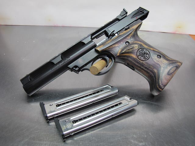 A Smith & Wesson 22A with composite wood grips