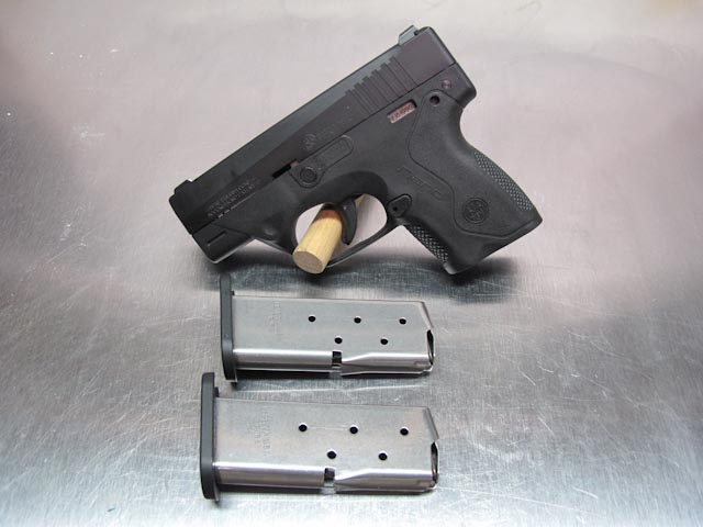 Side view of the Beretta Nano and magazines